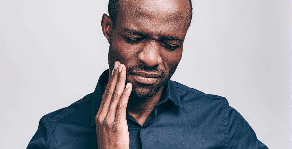 Man experiencing tooth pain